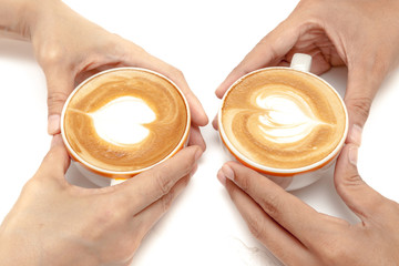 Wall Mural - Coffee cups of latte art heart shape, drinking together, on white background isolated