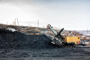 Crawler excavator in a coal quarry