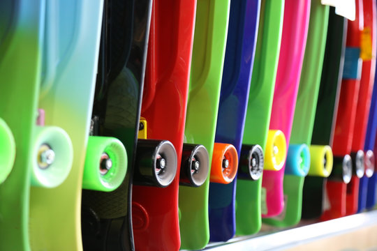 colorful skateboards are sold in the store. bright and vibrant colors. center focus photography