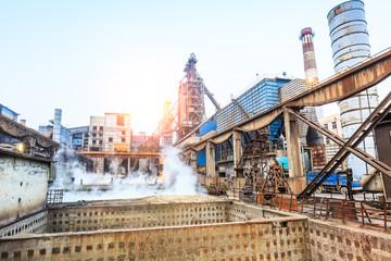 Steel plant sewage pool and industrial buildings