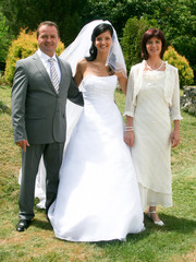Family Group At Wedding bride with parents. Just married. Family photo memory. Wedding dresses.