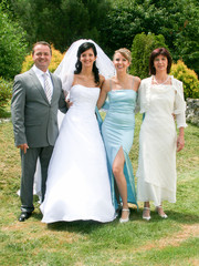 Family Group At Wedding bride with parents and sister. Just married. Family photo memory. Wedding dresses.