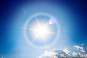 Beautiful fantastic sun halo phenomenon in sky, Miraculous sun with circular rainbow.