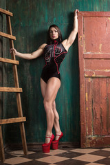 Girl, model, champion, sportsman bodybuilding in a photo studio in a beautiful image. Style, bodybuilding, lifestyle, beauty, fashion.