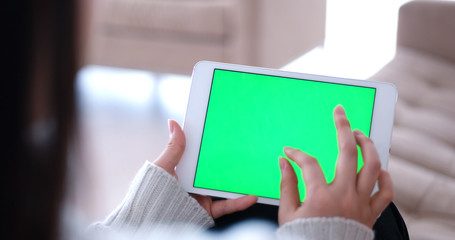 woman on sofa using tablet computer