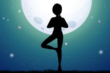 Silhouette woman doing yoga on fullmoon night