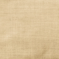 Hessian sack cloth texture canvas fabric pattern background in light yellow cream brown color