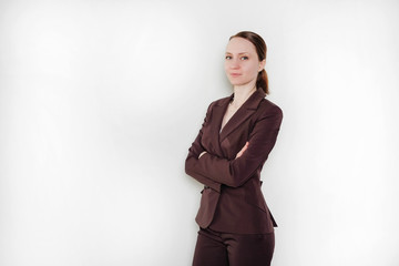 Attractive girl in a suit on a white isolated background. Business concept.
