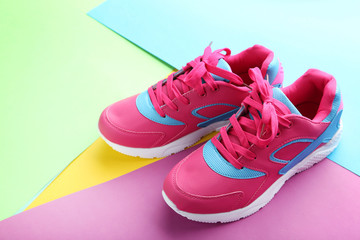 Sport shoes on colorful paper background