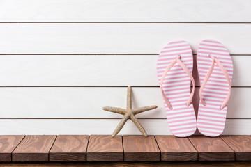 Flip flops on wooden background