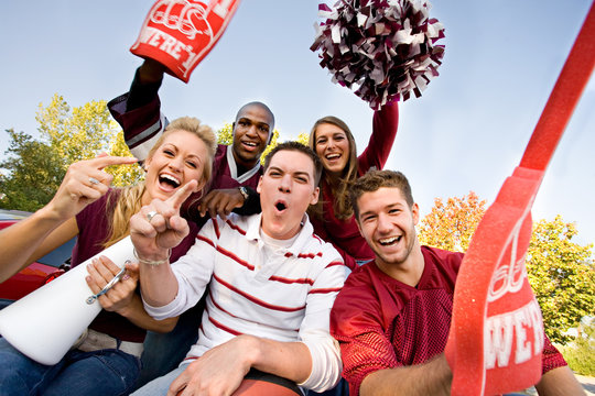 Tailgating: Excited Group Of College Football Fans