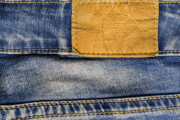Leather label of a blue jeans