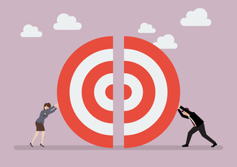 Businessman and woman pushing a pieces of big target together