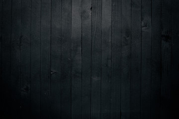 Black wooden surface. Free space for your text. Top view.