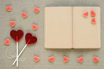 Heart-shaped lollipops, candies and an old diary