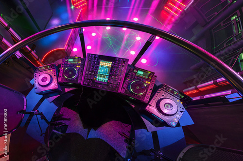 """""""DJ Mixing Music On Console At The Colorful Interior Of"""