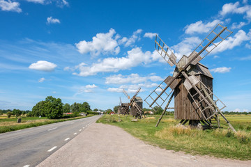 "Row of traditional windmills at Lerkaka on Swedish island Oland in the Baltic Sea. Windmills are a common sight on Oland, which is nicknamed ""the island of the sun and winds""."