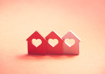 Three small houses with heart
