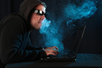 smoking man doing cybercrime