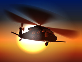 Silhouette helicopter Black hawk helicopter flies in sunset.