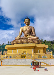 Front view of giant Buddha Dordenma statue with the blue sky and clouds background, Thimphu, Bhutan