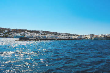 Entering Harbor with blue sky and blue water, Mykonos, Greece