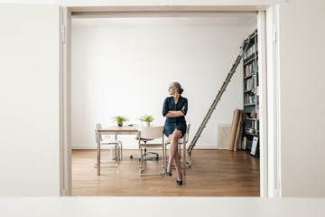 Businesswoman sitting in modern office