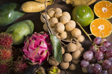 group of thai fruit on wood table