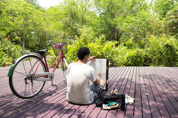 Artist sketching nature on drawing board