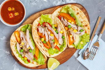 Fajitas with chicken, vegetables and spicy sauce salsa.
