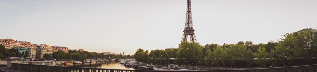 Famous Paris tower  named Eiffelin the sunrise from the bridge.