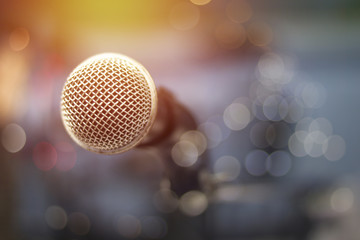 microphone and bokeh background, concept as music instrument in studio room and meeting hall
