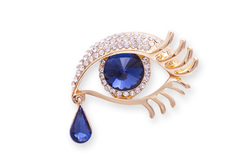 Wall Mural - Gold brooch eye with diamonds аnd a large sapphire isolated on white