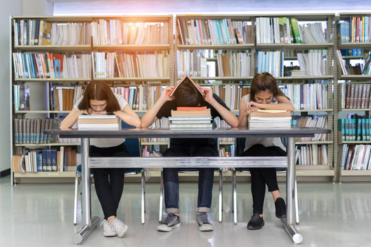 Young Student Group Reading Book Serious, Hard Exam, Quiz, Test Sleeping .headache worry in Classroom Education Library University Knowledge center