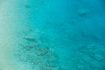 Ocean aerial view turquoise blue sea water gradient