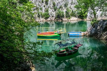 Fototapeta Old boats docked in the small bay at Matka Canyon, Skopje, Macedonia obraz