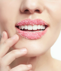 Lips of beautiful young woman covered with sugar, closeup