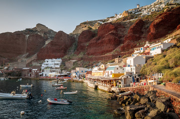 Amoudi, Santorini island, Greece. Amoudi bay is located below Oia village. Boats and taverns near the water.