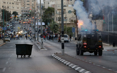 Israeli police vehicle fires tear gas canisters towards Palestinian protesters during clashes in the West Bank city of Bethlehem