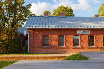 STAMERIENE, LATVIA - OCTOBER 15, 2016: Country train station, red brick architecture