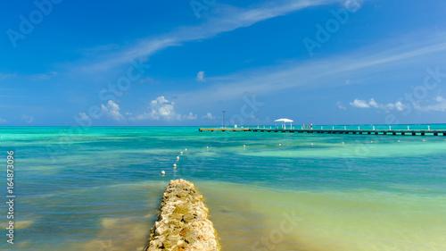 View of Rum Point pier on the Caribbean sea, Grand Cayman ... Caribbean Sea Cayman Islands on nassau caribbean, saint-martin caribbean, belize caribbean, cooper island caribbean, caicos caribbean, pennsylvania caribbean, windward islands caribbean, el salvador caribbean, eustatius caribbean, union island caribbean, monaco caribbean, anegada caribbean, virgin islands caribbean, guam caribbean, dominica island caribbean, jamaica caribbean, peter island caribbean, guatemala caribbean, chile caribbean, st barts caribbean,