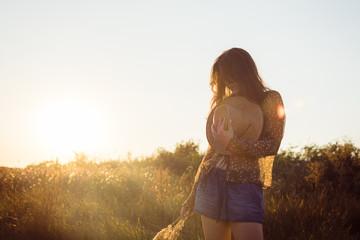 Young hippie beautiful woman enjoying day in nature
