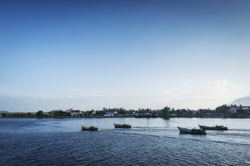 view of traditional fishing boats on kampot river in cambodia