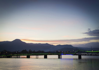 view of old bridge in kampot town cambodia at sunset
