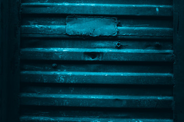 Shabby blue painted rusty iron wall texture background. Abstract wallpaper. Perfect texture for the interior exterior any possible industrial grunge background. Old train panel. Close up