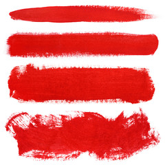 Set of red strokes of gouache paint brush isolated on white