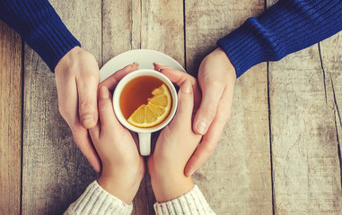 Lovers drinking tea. Selective focus.