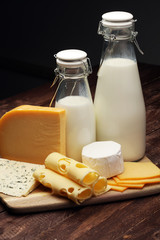 milk products - tasty healthy dairy products and milk jar, glass