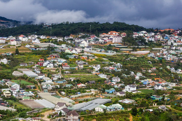 Dalat city in Vietnam top view from above with stormy clouds over the town.