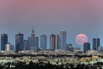 Rising moon over Warsaw city, Poland
